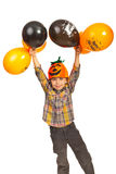 Happy boy holding Halloween balloons. Happy boy with pumpkin hat holding up Halloween balloons isolated on white background Stock Images