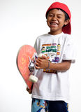 Happy boy holding his skateboard stock image