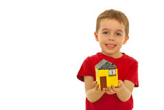 Happy boy holding home miniature Royalty Free Stock Image