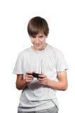 Happy boy holding the joys isolated on white Royalty Free Stock Image