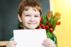 Happy boy holding a piece of paper blank Stock Photo