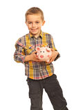 Happy boy holding piggybank Royalty Free Stock Images