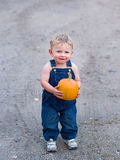 Happy boy holding pumpkin Stock Photography