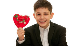 Happy boy holding red heart with roses on it Stock Images