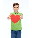 Happy boy holding red heart shape Stock Photography