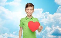 Happy boy holding red heart shape Royalty Free Stock Photo