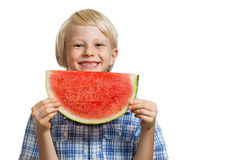 Happy boy holding slice of watermelon Stock Image