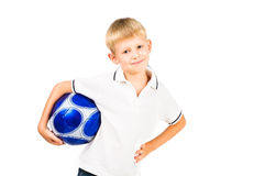 Happy boy holding soccer ball Stock Photos