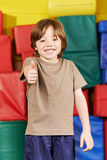 Happy boy holding thumbs up Royalty Free Stock Photography