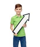 Happy boy holding white blank arrow banner Royalty Free Stock Photo