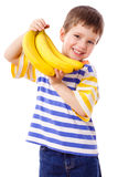 Happy boy holds a bunch of bananas Royalty Free Stock Photos