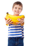 Happy boy holds a bunch of bananas Stock Photo