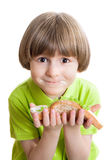 Happy boy holds a sandwich Royalty Free Stock Photos