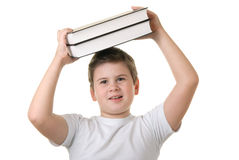 Happy boy holds some books over head Royalty Free Stock Photos