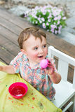 Happy Boy Holds Up His Pink Dyed Easter Egg Stock Photos