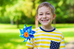 Happy boy holds windmill in hand Stock Photography