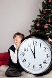 Happy boy hugs Christmas gift Royalty Free Stock Photography