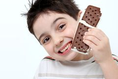 Happy Boy with Ice Cream Sandwich Stock Photos