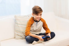 Happy boy with joystick playing video game at home Royalty Free Stock Images