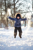 Happy boy jump outdoors Royalty Free Stock Photos