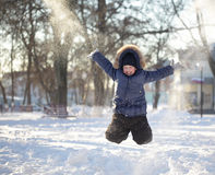 Happy boy jump outdoors Royalty Free Stock Images