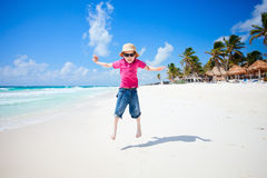 Happy boy jumping on beach Stock Image