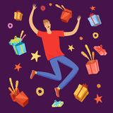 Happy boy jumping with gift boxes around him Royalty Free Stock Image