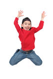 Happy boy jumping midair. Happy young preschool boy jumping in midair, isolated on white background stock photos