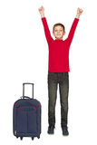 Happy boy jumping near travel bag isolated on white Royalty Free Stock Images