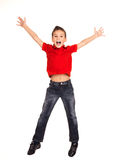 Happy boy jumping with raised hands up. Portrait of  laughing happy boy jumping with raised hands up - isolated on white background Royalty Free Stock Photos