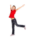 Happy boy jumping with raised hands up. Portrait of  laughing happy boy jumping with raised hands up - isolated on white background Stock Photos