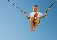 Happy boy jumping on the rope Stock Photos