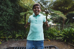 Happy boy jumping on trampoline at park Royalty Free Stock Photos