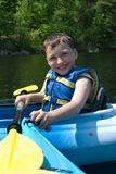 Happy boy kayaking royalty free stock images