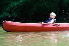 Happy boy kayaking on the river royalty free stock photos
