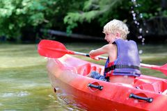 Happy boy kayaking on the river Stock Image