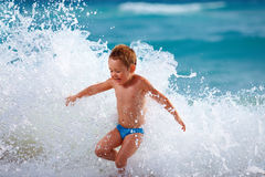Happy boy kid having fun in sea water Royalty Free Stock Photography