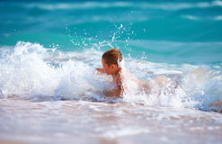 Happy boy kid having fun in sea water Stock Photography