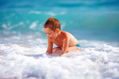 Happy boy kid having fun in sea water Stock Photos
