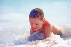 Happy boy kid having fun in sea water Royalty Free Stock Photo
