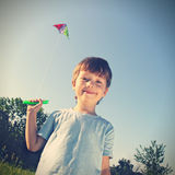 Happy boy with kite Royalty Free Stock Photography