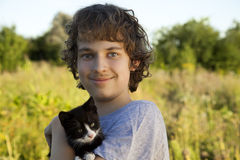 Happy boy with a kitten Stock Photography