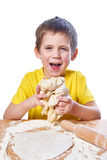 Happy boy kneads dough isolated Stock Photo