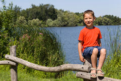 Happy boy on the lake royalty free stock photos