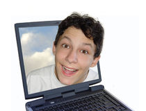 Happy boy in laptop Stock Photos