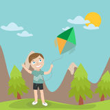 Happy Boy Launches Kite in the Mountains Stock Images