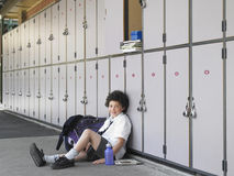 Happy Boy Leaning Against School Lockers Royalty Free Stock Image