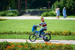 Happy boy learning to ride his first bike Stock Photography