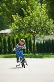 Happy boy learning to ride his first bike Royalty Free Stock Photo