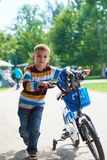 Happy boy learning to ride his first bike Royalty Free Stock Images